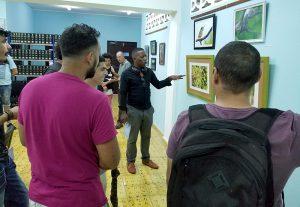 Inauguración de exposición fotográfica Terra Nostra. Al centro, Victor Vaillant, artista participante