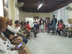 Taller Críticas contemporáneas al racismo y la discriminación racial. Sandra Abd'Allah-Álvarez junto a integrantes del Proyecto Lo llevamos rizo